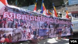 Some 300 people, including monks and students, marched through the capital on Friday, protesting a refugee deal between Cambodia and Australia.
