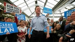 Britain's Prime Minister and Conservative Party leader David Camer speaks to supporters in Twickenham, London, Tuesday May 5, 2015. (AP Photo/Peter Nicholls, Pool)