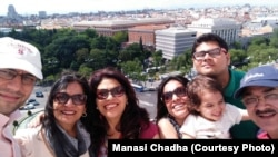 Manasi Chadha (with baby in arms) travelled to Spain with six family members this summer.