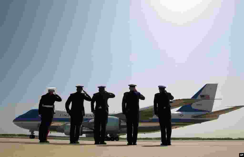 President Barack Obama is celebrating Earth Day with a visit to the Everglades to talk about how global warming threatens the U.S. economy. In this photo, military personnel salute as Air Force One departs with the president aboard from Andrews Air Force Base, Maryland on its way to the Everglades, April 22, 2015.