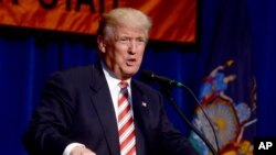 FILE - Republican presidential candidate Donald Trump speaks at the Conservative Party of New York State's 2016 presidential reception, Sept. 7, 2016.