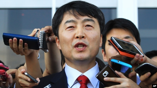 Lee Seok-ki of the leftist Unified Progressive Party speaks before leaving the National Assembly in Seoul, South Korea, Sept. 4, 2013.
