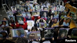 "Students hold portraits of deceased former South Korean ""comfort women"" during a weekly anti-Japan rally in front of Japanese embassy in Seoul, South Korea, December 30, 2015."