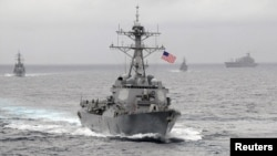 FILE - The guided-missile destroyer USS Lassen sails in the Pacific Ocean in a November 2009 photo provided by the U.S. Navy.