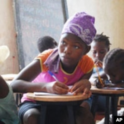 Young Sierra Leonean girl receives basic education from humanitarian agency GOAL