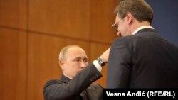 Russian President Vladimir Putin awards Serbian President Aleksandar Vucic with a medal in Belgrade, Serbia, January 17, 2019