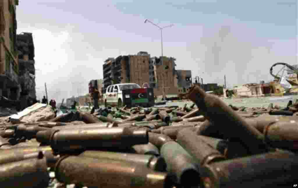 Bullet casings litter a street in Misrata, April 23, 2011. (AP image)