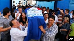 Relatives carry a coffin with the remains of Rodrigo Quintana, a member of the Authentic Radical Liberal Party, who was killed in an incident at party's headquarters away from congress at the party's headquarters on Friday, in Asuncion, Paraguay, April 1,