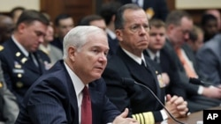 U.S. Secretary of Defense Robert Gates (L) and Chairman of the Joint Chiefs of Staff Adm. Mike Mullen testify at a House Armed Services Committee hearing on Operation Odyssey Dawn and U.S. Military Operations in Libya, Mar 31 2011