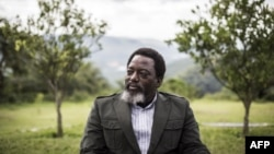 FILE - President of the Democratic Republic of the Congo, Joseph Kabila, sits in a garden at his personal ranch in Kinshasa, Dec. 10, 2018.