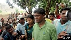 Member of Orissa state legislature Jhina Hikaka walks towards Balipeta village in Koraput district in India after being released by Maoist rebels on April 26, 2012.