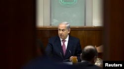 Israel's Prime Minister Benjamin Netanyahu is seen chairing the weekly cabinet meeting in Jerusalem July 28, 2013.