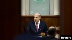 Israel's Prime Minister Benjamin Netanyahu is seen chairing the weekly cabinet meeting in Jerusalem July 28, 2013.