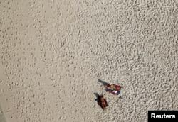 An aerial view shows people on Barra da Tijuca beach in Rio de Janeiro, Brazil, July 16, 2016.
