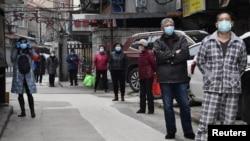 Izolacija se u provinciji koja je bila žarište korona virusa ipak ukuda postepeno, Foto: REUTERS/Stringer CHINA OUT. - RC2PDF9U1064