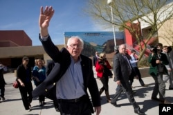 Democratic presidential candidate Sen. Bernie Sanders of Vermont waves to voters as he leaves a caucus site in Las Vegas, Feb. 20, 2016.