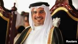 FILE - Bahrain's Crown Prince Salman bin Hamad al-Khalifa smiles during a ceremony organised by residents of Southern Governorate to show support and loyalty, in Riffa, south of Manama, April 10, 2013.