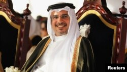 FILE - Bahrain's Crown Prince Salman bin Hamad al-Khalifa smiles during a ceremony organised by residents of Southern Governorate.