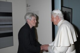 US artist Max Cole, 75, shakes hands with Pope Benedict in front of the painting she submitted to the Vatican exhibit.