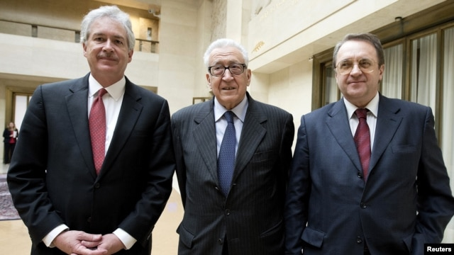 The Joint Special Representative for Syria Lakhdar Brahimi (C) stands with Russian Deputy Foreign Minister Mikhail Bogdanov (R) and U.S. Deputy Secretary of State William Burns as they meet at the United Nations European headquarters in Geneva, Switzerland, January 11, 2013.