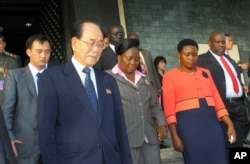 FILE - North Korea's ceremonial leader, Kim Yong Nam, foreground,left, the head of North Korea's parliament, is escorted into Uganda's parliament by its Speaker Rebecca Kadaga, center, Commissioner Rosemary Seninde, center-right, and Uganda's Foreign Affairs Minister Asuman Kiyingi, right, in Kampala, Uganda, Oct. 30,2014.