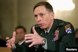 FILE - Lieutenant General David Petraeus testifies to the Senate Armed Forces Committee about his nomination to be general and commander of the Multi-National Forces in Iraq at a hearing on Capitol Hill in Washington, Jan. 23, 2007.