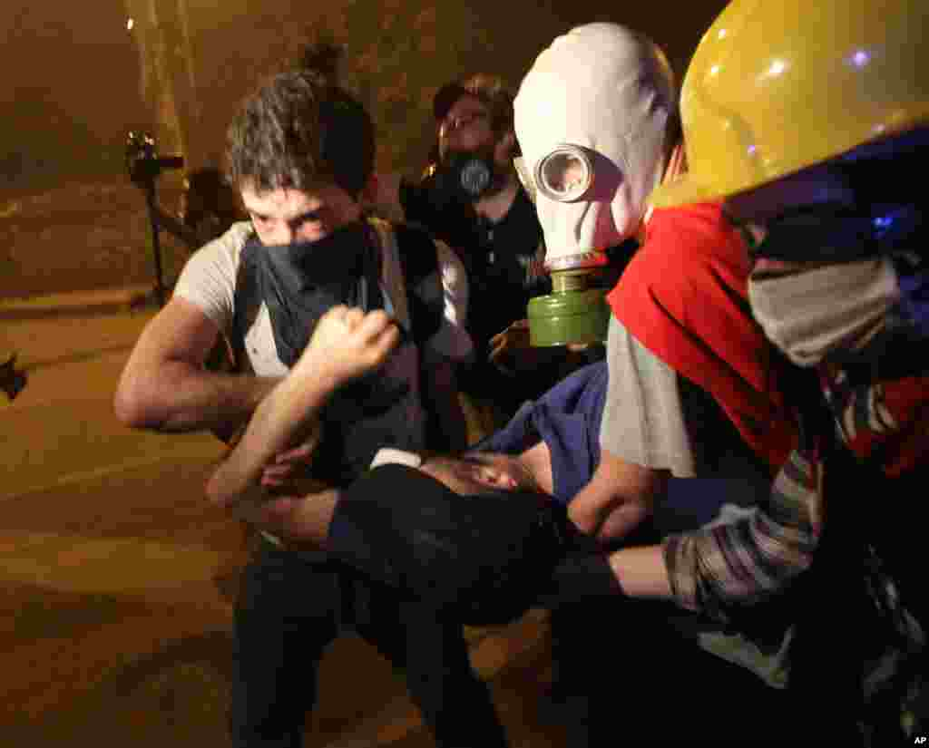 Youths carry an injured demonstrator during nationwide anti-government protests in Besiktas, Istanbul, June 2, 2013.