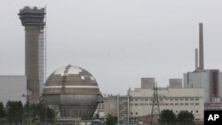 FILE - The Sellafield Nuclear Power Station in Sellafield, England, is seen in a May 23, 2007, photo. Developers see factory-assembled small modular reactors (SMRs) taking the place of some conventional nuclear plants.
