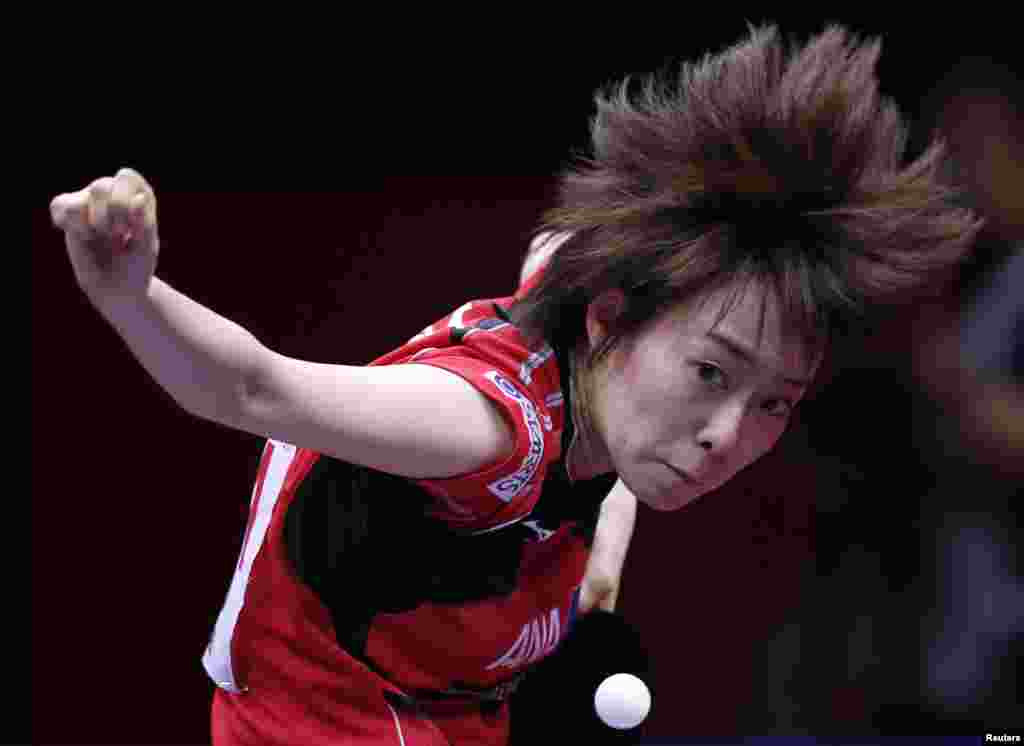 Japan's Kasumi Ishikawa serves to Hong Kong's Jiang Huajun during their women's semi-final match at the World Team Table Tennis Championships in Tokyo.