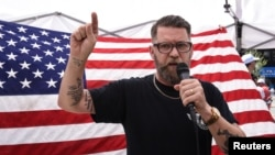 "Gavin McInnes speaks during an event called ""March Against Sharia"" in New York, June 10, 2017."