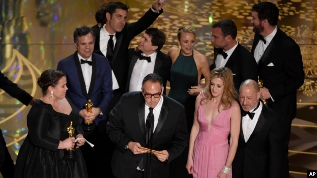 "Cast and crew from ""Spotlight"" celebrate their best picture win at the Academy Awards, Feb. 28, 2016."