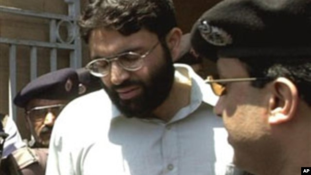 In this March 29, 2002 file photo, Ahmed Omar Saeed Sheikh, the alleged mastermind behind Wall Street Journal reporter Daniel Pearl's abduction, leaves the provincial high court in Karachi, Pakistan, under tight security