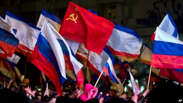 Pro-Russian people celebrate in Lenin Square, in Simferopol, Ukraine, March 16, 2014.