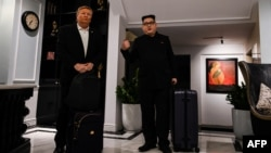 North Korean leader Kim Jong Un impersonator Howard X (R) and U.S. President Donald Trump impersonator Russel White walk at the lobby of a hotel before being escorted by Vietnamese authorities to the airport, in Hanoi, Feb. 25, 2019.