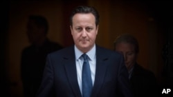 Prime Minister David Cameron leaves 10 Downing Street in London