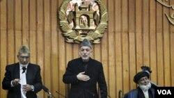 Prezidan afgan an Hamid Karzai (mitan)