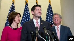 Rep. Paul Ryan, R-Wis., flanked by Rep. Cathy McMorris Rodgers, R-Wash., left, and House Majority Leader Kevin McCarthy of Calif., pauses during a news conference on Capitol Hill in Washington, Oct. 28, 2015, after a Special GOP Leadership Election. Republicans in the House of Representatives have nominated Ryan to become the chamber's next speaker.
