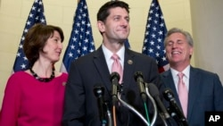 Representative Paul Ryan, Republican-Wisconsin, flanked by Representative Cathy McMorris Rodgers, Republican-Washington, left, and House Majority Leader Kevin McCarthy of California, after his nomination Wednesday as House speaker.