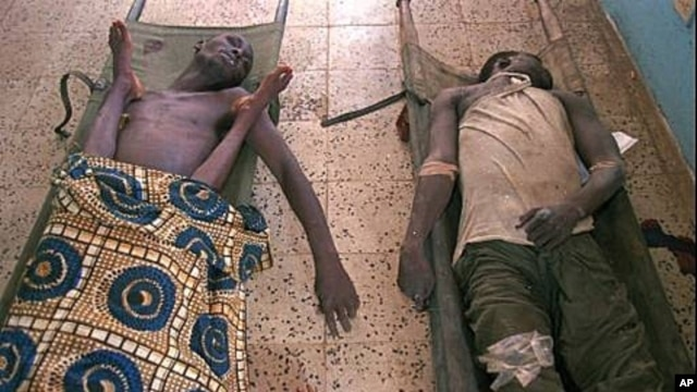 Bodies of three who died from cholera in a makeshift morgue, Liberia, 1996 (file photo).