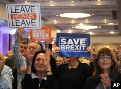 "FILE - Supporters during a ""Leave Means Leave Rally"" are seen at the National Conference Center, Solihull, central England, Sept 30, 2018, as the ruling Conservative Party starts its annual conference."