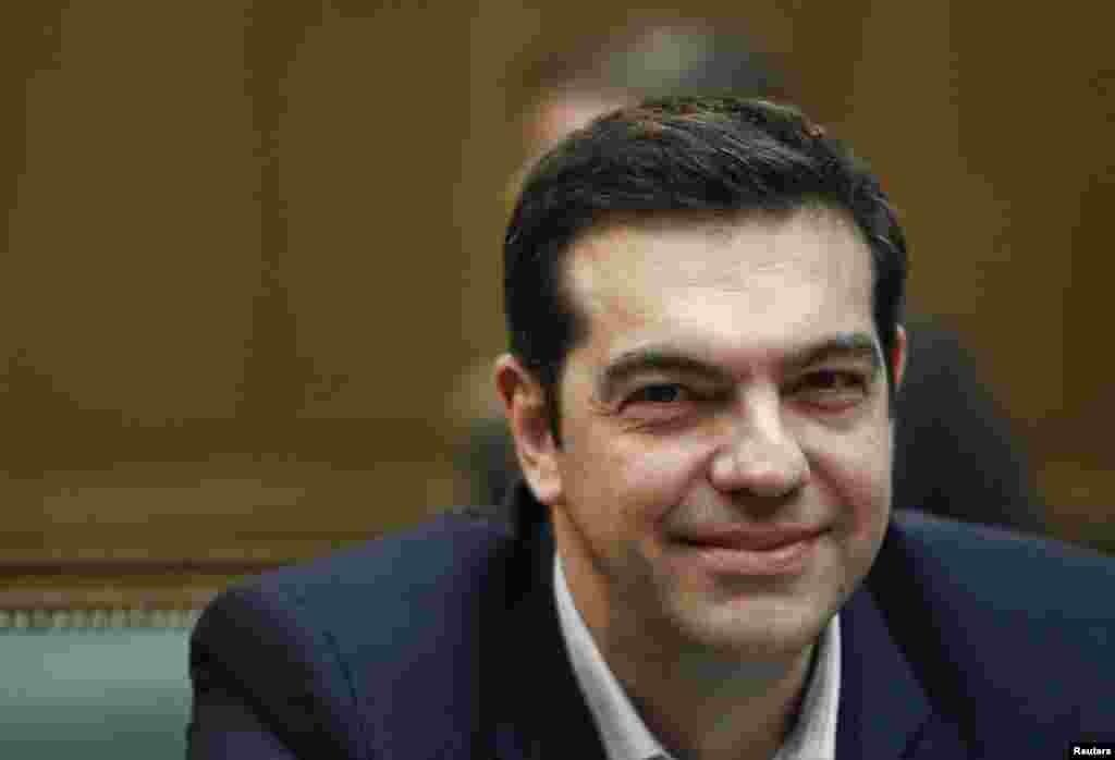 Greek Prime Minister Alexis Tsipras attends the first meeting of the new cabinet in the parliament building telling his ministers that voters had given them a mandate for radical change, in Athens, Jan. 28, 2015.