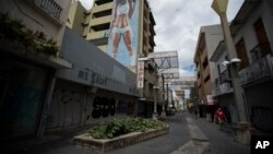 Shops are shuttered in the Paseo de Diego in San Juan, Puerto Rico, April 17, 2019. This central thoroughfare in Rio Piedras was filled years ago with stores that are closed and empty today.