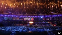 The Olympic cauldron is lit during the opening ceremony at the 2012 Summer Olympics in London, July 28, 2012.
