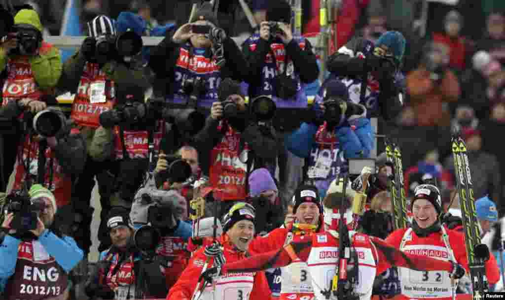 Ole Einar Bjoerndalen, Tarjei Boe, Emil Hegle Svendsen and Henrik L'Abee-Lund of Norway (L to R) celebrate their victory in the men's 4x7.5 km relay during the International Biathlon Union World Championships in Nove Mesto, Czech Republic.