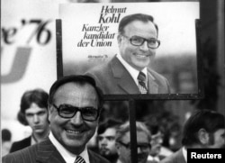 FILE - Helmut Kohl stands in front of an election poster, June 26, 1975, during an election campaign for the West German 1976 general election.