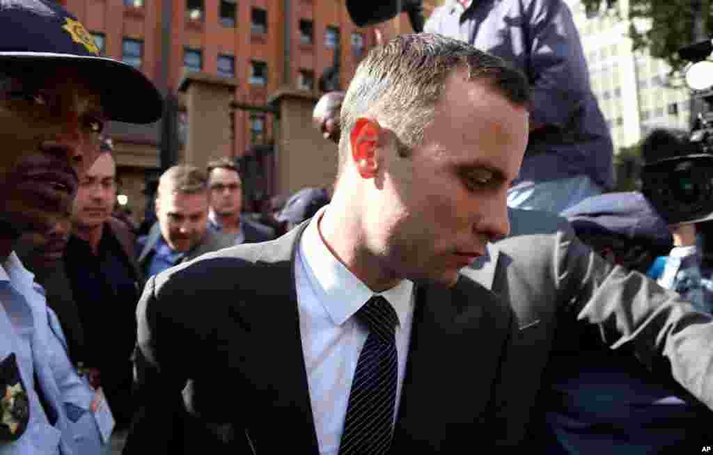 Oscar Pistorius leaves the high court in Pretoria, April 8, 2014.