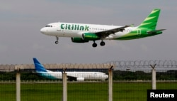 FILE - A Citilink Airbus A320 approaches for a landing at Soekarno–Hatta International Airport in Jakarta June 14, 2013.