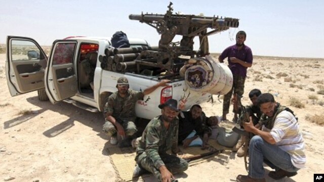 Libyan rebels make their way to frontline, 40 km west of Ajdabiyah, July 18, 2011