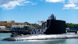 In this photo provided by US Navy, the Virginia-class fast-attack submarine USS Illinois returns home to Joint Base Pearl Harbor-Hickam from a deployment in the 7th Fleet area of responsibility on Sept. 13, 2021.