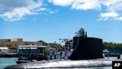 In this photo provided by US Navy, the Virginia-class fast-attack submarine USS Illinois (SSN 786) returns home to Joint Base Pearl Harbor-Hickam from a deployment in the 7th Fleet area of responsibility on Sept. 13, 2021.